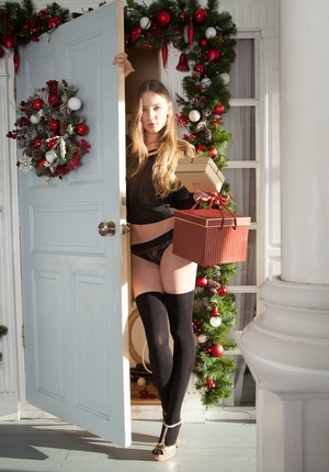Doll takes off underwear and heels showing body and long legs on the Christmas eve