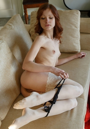 Underweight redhead Emanuelle fingering herself in sexy white stockings