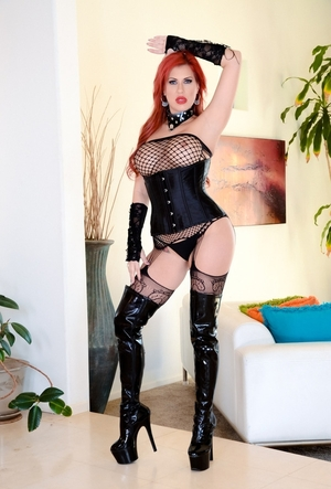 Ravishing Sexually available mom with red hair and also juicy tits poses on cam dressed in latex boots