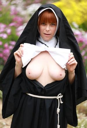Ginger nun exposes milky tits and untapped pinky flower in the field