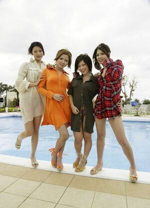 More than one Japanese chicks gladly pose on camera outdoors by spacious pool