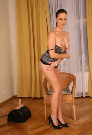 Tall Sexually available mom brunette puts condom on sybian machine and turns it on for a ride