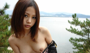 Asiatic broad with sunglasses on looks so seriously cause she is shy being naked