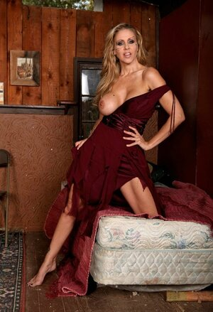 Lady in a different dress finally takes it off in her wooden bedroom